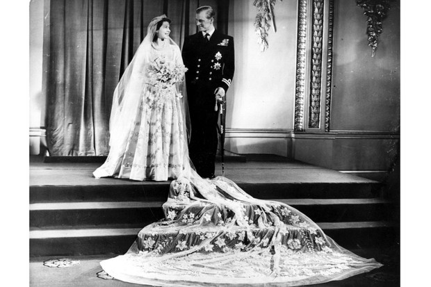The future Queen Elizabeth II and her husband, Prince Philip, Duke of Edinburgh, at Buckingham Palace following their wedding, 20 November 1947. (Photo by Hulton Archive/Getty Images)