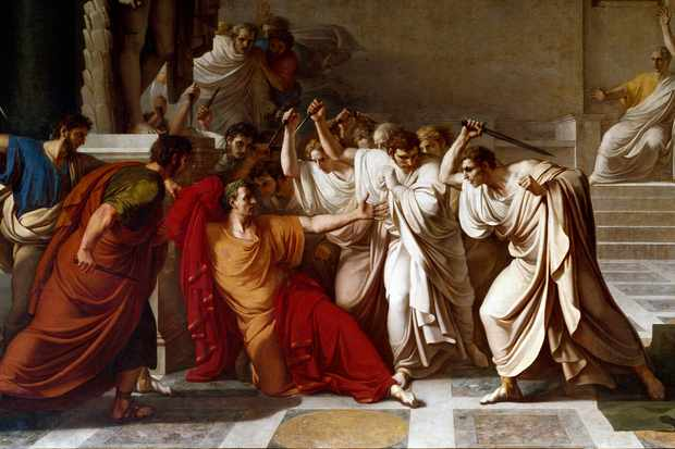 A group of men wearing togas assault Julius Caesar in this painting depicting his assassination.