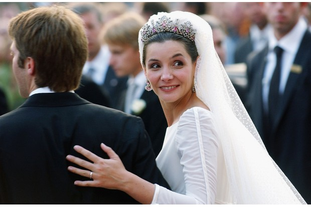French actress Clotilde Courau looks over the shoulder of her new husband Emanuele Filiberto