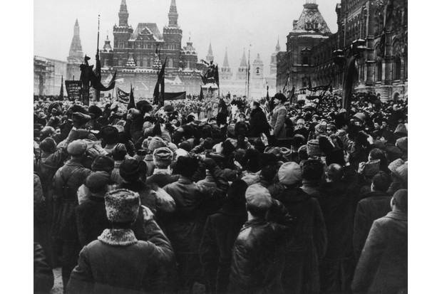 View of a large crowd assembled in Red Square, with Bolshevik leaders Joseph Stalin (right) and Leon Trotsky standing on a podium, during the Russian Revolution, Moscow, Russia. (Photo by Hulton Archive/Getty Images)