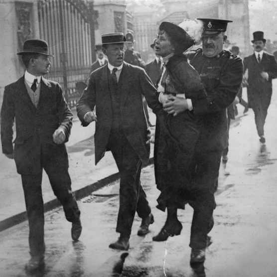 Outside Buckingham Palace, English suffragette Emmeline Pankhurst (1858 - 1928), is arrested and carried away by Superintendent Rolfe at a march, organised by Pankhurst, to petition King George V, London, 21st May 1914. On arrival at the palace, the marchers were met with force by the police and violence from the crowd of onlookers.  (Photo by Jimmy Sime/Central Press/Hulton Archive/Getty Images)
