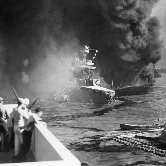 The battleship USS California (centre) following the attack at Pearl Harbor, 7 December 1941. (Bettmann/Getty Images)