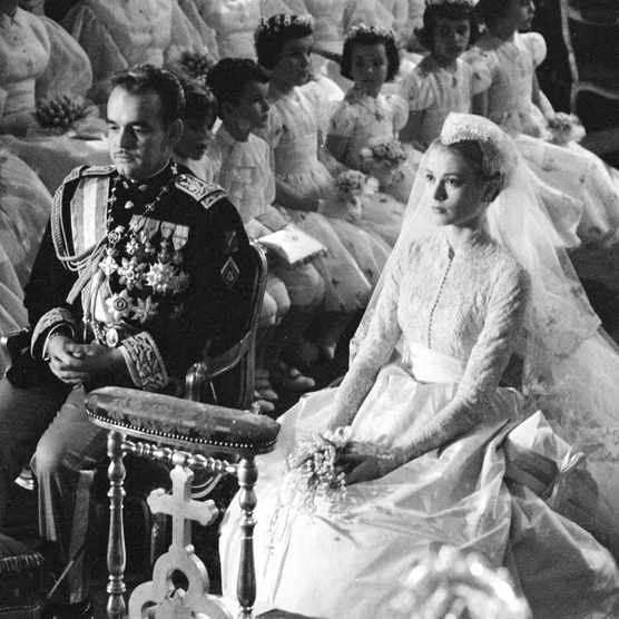 Prince Rainier of Monaco and American actress Grace Kelly (1929 - 1982) sit before the altar during their wedding ceremony at the Cathedral of Saint Nicholas, Monte Carlo, Monaco, April 19, 1956. Kelly's gown was designed by costume designer Helen Rose. (Photo by Thomas McAvoy/The LIFE Picture Collection/Getty Images)
