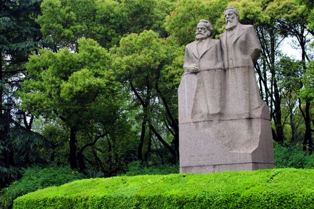 Communist monument depicting the two authors of the Communist Manifesto, Karl Marx and Friedrich Engels, in Fuxing Park, Shanghai, China.