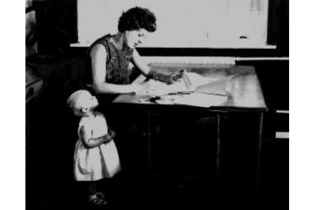 Computer programmer Ann Moffatt sits at her kitchen table in 1968