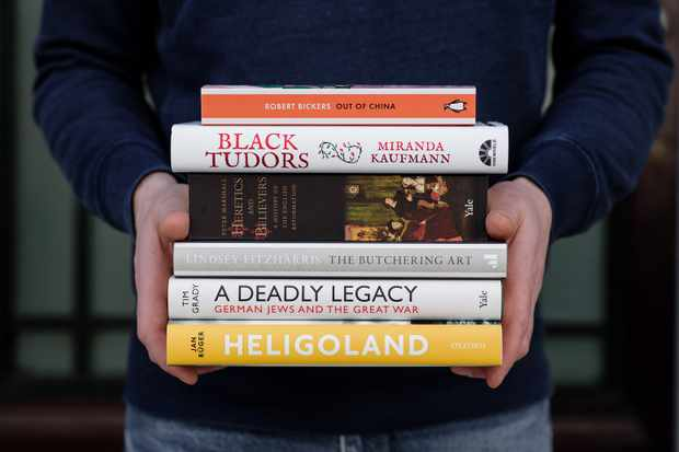 A person holding all of the shortlisted books for the Wolfson History Prize 2018