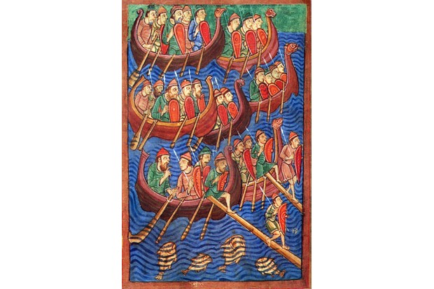 "Vikings disembark in England in a 12th-century manuscript. Ubbe and Ivar the Boneless, both of whom were described as ""sons of Ragnar"", attacked north-east England in 865. (Image by Alamy)"