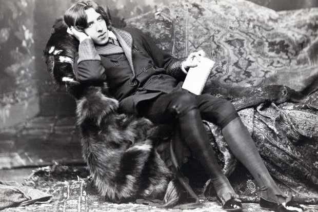 During his time in Oxford, Wilde fully embraced 'aesthetic flair': growing his hair long; dressing in flamboyant fashions and assuming exaggerated affectations. (Photo by Universal History Archive/Getty Images)