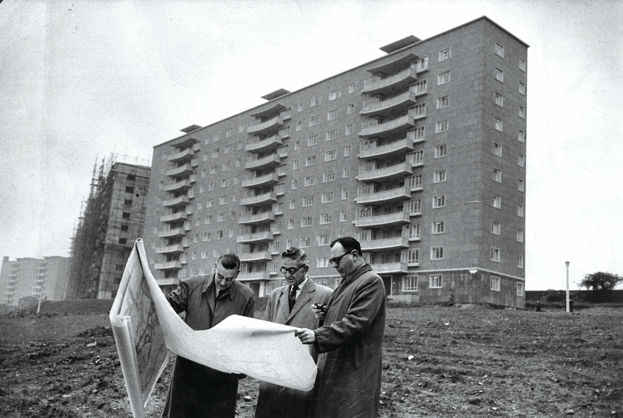 A councillor and architects discuss plans for the Moss Heights development in Glasgow, 1953. Proponents of high-rise flats believed that they would provide