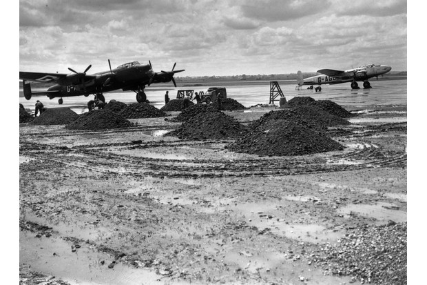 Waterlogged runways at Heathrow (then known as London Airport) on 28 May 1946, one week before the airport became Britain's main aerial gateway to the United States. (Photo by Harry Todd/Fox Photos/Getty Images)