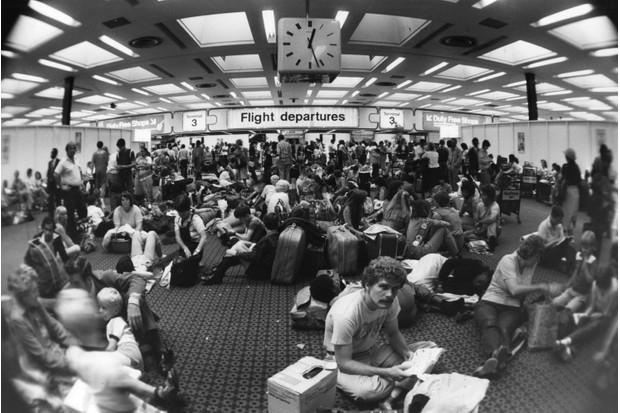 Holiday-makers waiting in the departure lounge at Terminal Three of London's Heathrow airport during delays caused by industrial action taken by Canadian air traffic controllers, 11 August 1981. (Photo by Keystone/Getty Images)
