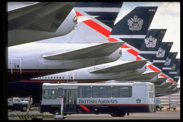 A line of British Airways-crested plane tails and an empty BOAC airline shuttle bus at Heathrow Airport, 5 June 1990. (Photo by Peter Jordan/The LIFE Images Collection/Getty Images)