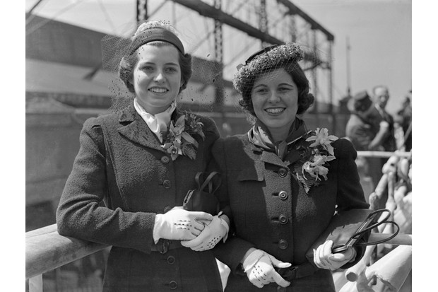 Eunice (left) and Rosemary Kennedy, pictured aboard the SS Manhattan, sailing from New York in April 1938 to join their parents in London. (Image by Bettmann/Getty Images)
