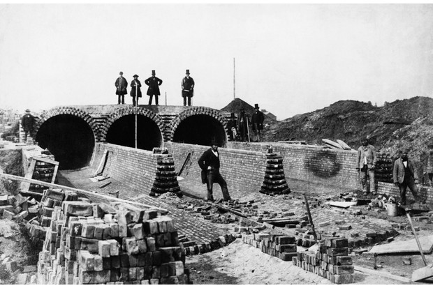 The sewerage system of Joseph Bazalgette, a 19th-century civil engineer, revolutionised London living conditions in the second half of the century. He is pictured top right, at Outfall Sewer, the largest sewer in London, at Barking Creek. (Photo by © Hulton-Deutsch Collection/CORBIS/Corbis via Getty Images)