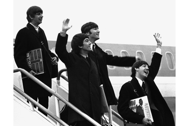 The Beatles arrive at London Airport upon their return from America, February 1964. They wave at the many fans who have come to the airport to greet them. (Photo by © Hulton-Deutsch Collection/CORBIS/Corbis via Getty Images)