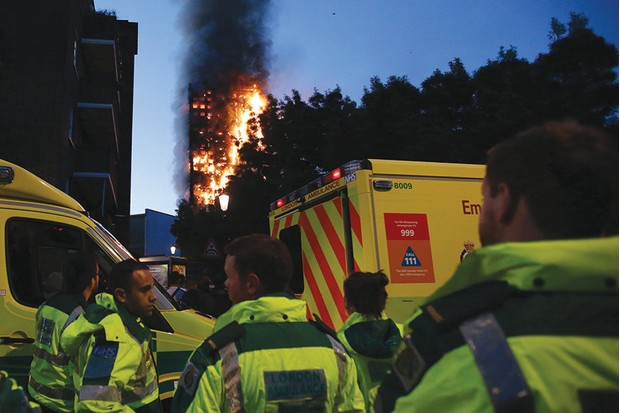 Fire devastates the 24-storey Grenfell Tower in west London, June 2017. (Photo by DANIEL LEAL-OLIVAS/AFP/Getty Images)