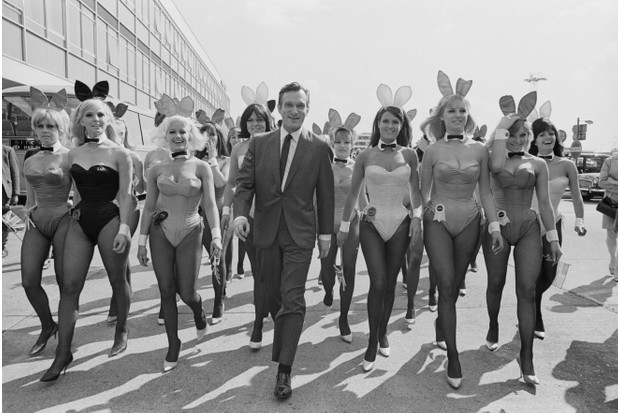 Playboy founder Hugh Hefner (1926-2017) with a group of bunny girls at Heathrow, 25 June 1966. Hefner had flown in for the opening of the London Playboy Club in Mayfair. (Photo by Ted West/Central Press/Hulton Archive/Getty Images)