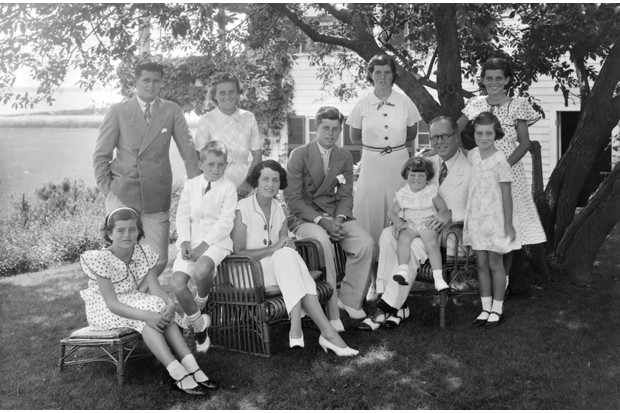 A portrait of the Kennedy family in Hyannis Port, Massachussetts, 1930s. Sitting L to R: Patricia, Robert, Rose Kennedy, John, Joseph Sr with Edward on his lap; standing L to R are: Joseph Jr, Kathleen, Rosemary, Eunice and Jean. (Photo by Bachrach/Getty Images)