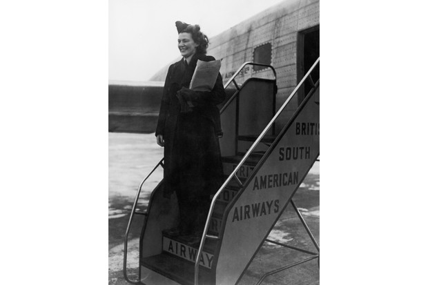 British South American Airways hostess Mary Guthrie about to board a converted Lancaster bomber named Starlight at London Airport, before a test-flight to Buenos Aires, 1 January 1946. The flight was the first from the newly-inaugurated airport. (Photo by Fred Morley/Fox Photos/Hulton Archive/Getty Images)