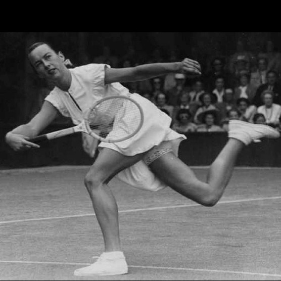 22nd June 1949: American tennis player Gertrude Moran, or Gorgeous Gussie, in action on her way to beating F M Wilford at Wimbledon. (Photo by George W. Hales/Fox Photos/Getty Images)