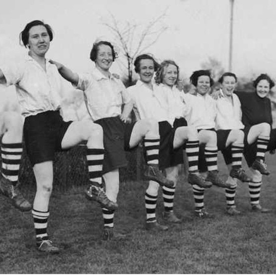 Members of Preston Ladies' Football Club (formerly Dick, Kerr's Ladies) pose while carrying out leg exercises during practice, March 1937. (Photo by Fox Photos/Hulton Archive/Getty Images)