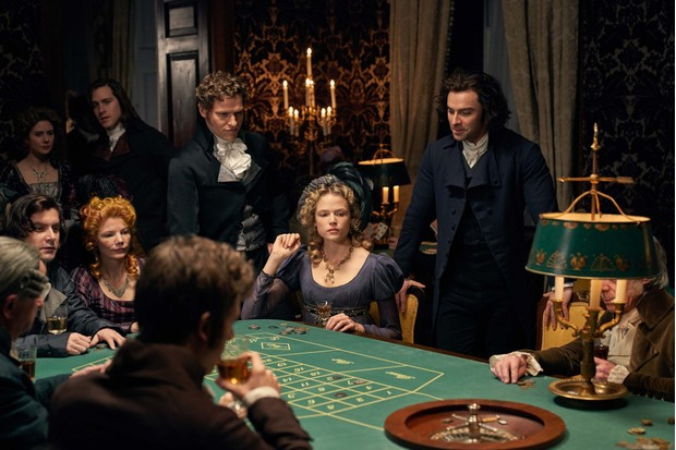 There were plenty of pleasures on offer in 18th-century London, explains Hannah Greig. Here, Ross Poldark and Caroline Enys are diverted by evening gambling tables. (Image Credit: BBC/Mammoth Screen/Robert Viglasky)