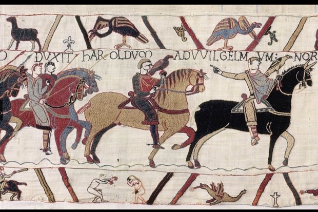 A scene from the Bayeux Tapestry depicting a naked man with an erection reaching out towards a naked woman, who is covering both her face and her pudenda with her hands. (© Bayeux Museum)