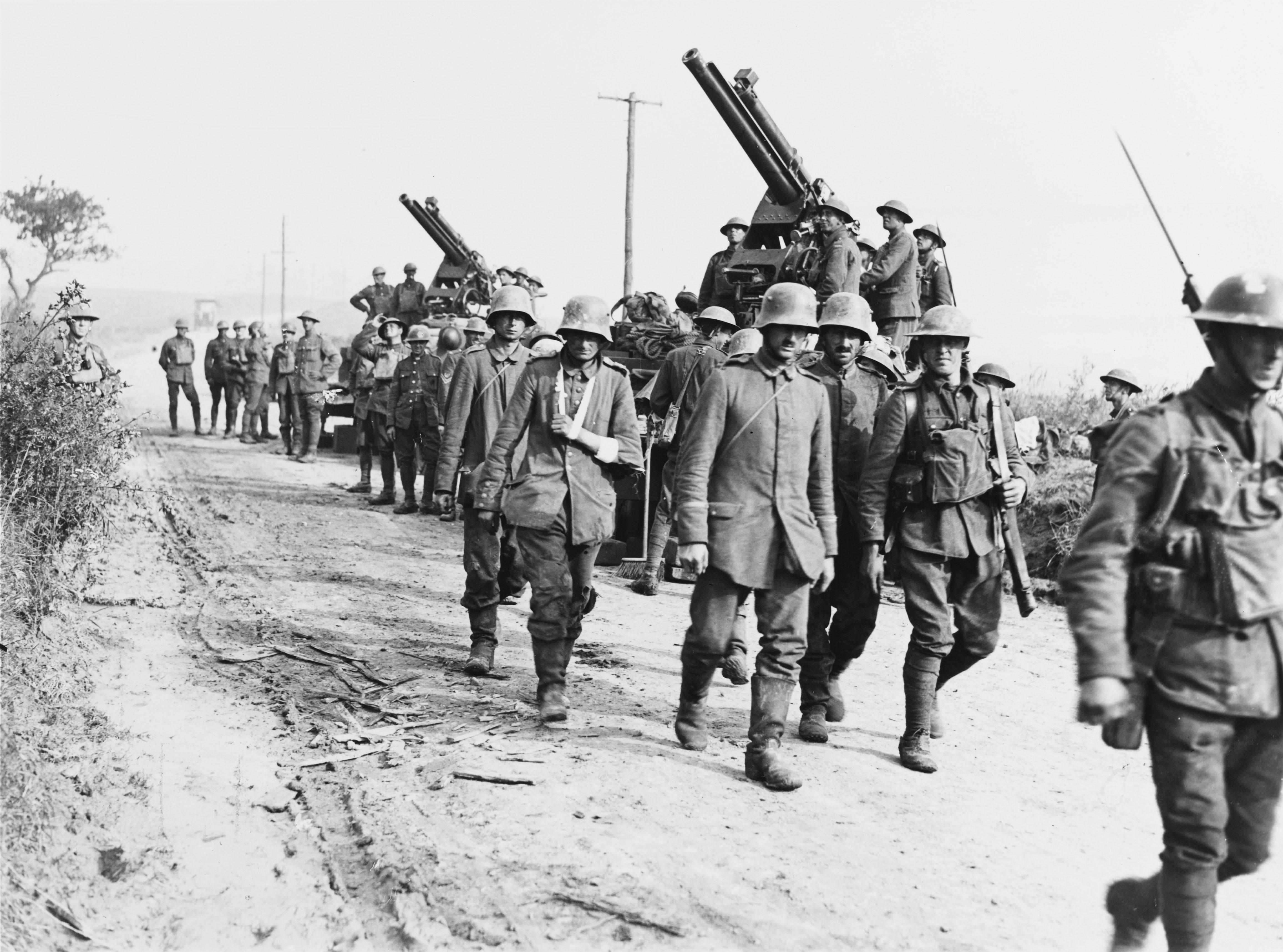 German prisoners traipse past Allied anti-aircraft positions near Méricourt-l'Abbé, August 1918. The battle of Amiens fired the starting-gun on a succession of Allied triumphs on the western front that would end in ultimate victory on 11 November. (Photo by Alamy)