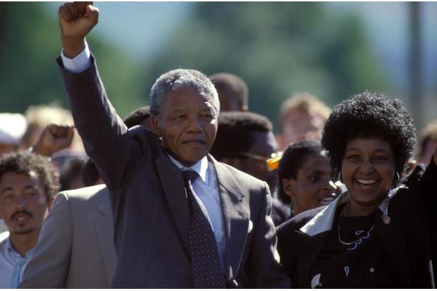 Mandela walks free after 27 years of imprisonment. He is accompanied by his wife, Winnie Madikizela-Mandela. (Photo by Pool BOUVET/DE KEERLE/Gamma-Rapho via Getty Images)