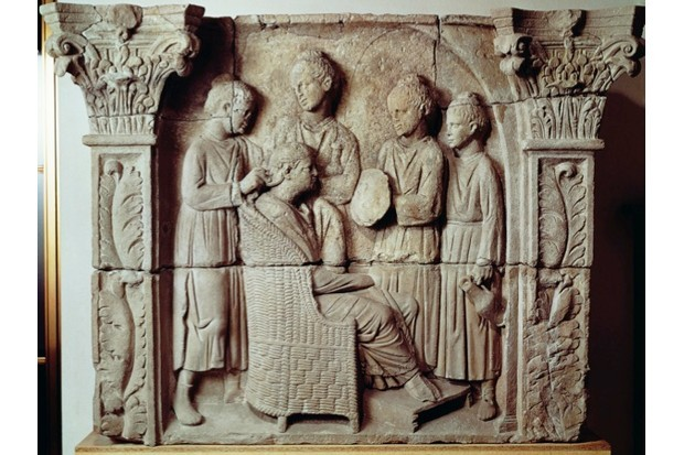 Second-century relief portraying a lady having her hair styled. (Getty Images)