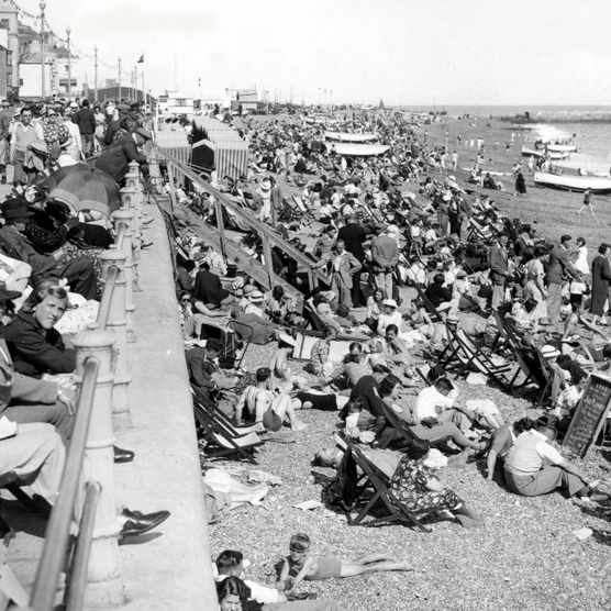Crowds flock to the beach at Hastings in August 1938. (Photo by Photo12/UIG/Getty Images)