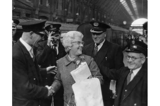 On the morning of 30 July 1966, Cissie Charlton is greeted by station staff at King's Cross, London. Her sons Bobby and Jackie played for England in the 1966 World Cup final against Germany. (Photo by Keystone/Getty Images)