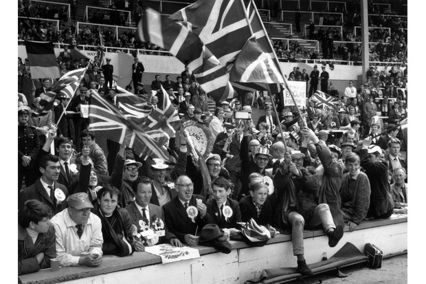 England football fans at Wembley Stadium on 30 July 1966. On 26 July, England's football team had faced Portugal in the semi-finals, and although Portugal's star player Eusébio had scored his ninth goal of the tournament, the hosts won 2-1 to set up the final with West Germany. (Photo by A. Jones/Evening Standard/Getty Images)