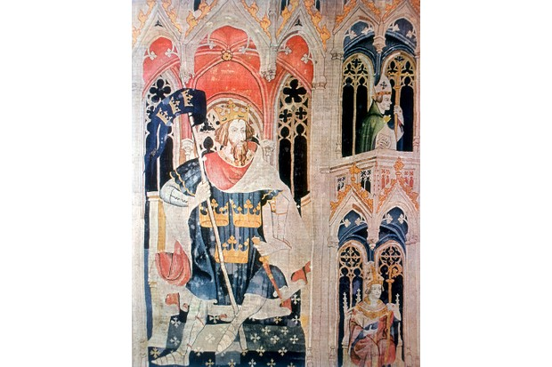 A late 14th-century tapestry depicting King Arthur, who, according to legend, led a pro-British force against the Saxons, winning a great victory at Badon Hill in the late fifth or early sixth century. (Photo by Ann Ronan Pictures/Print Collector/Getty Images)