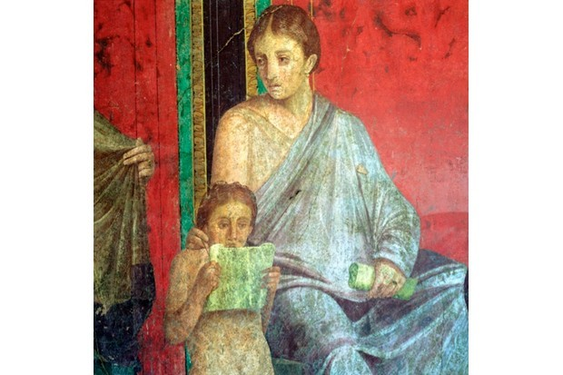 Fresco detail of a young girl reading, from the first century BC. (Getty Images)