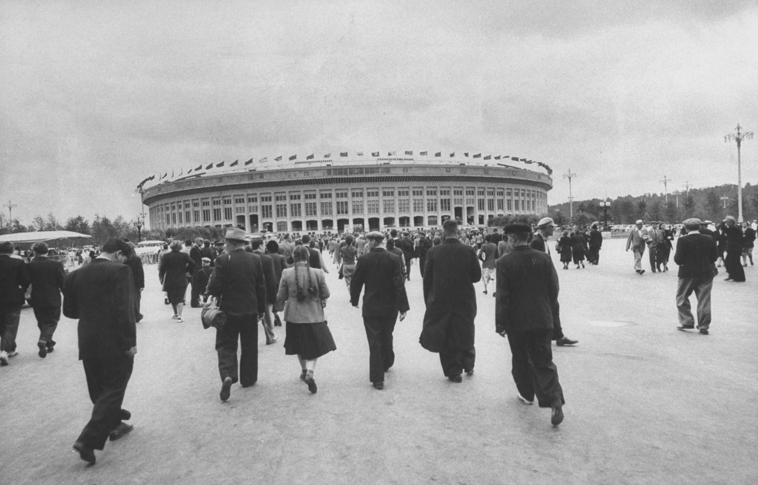 People approach the VI Lenin Stadium, now known as the Luzhniki Stadium, in Moscow, in 1956. (Photo by James Whitmore/The LIFE Images Collection/Getty Images)