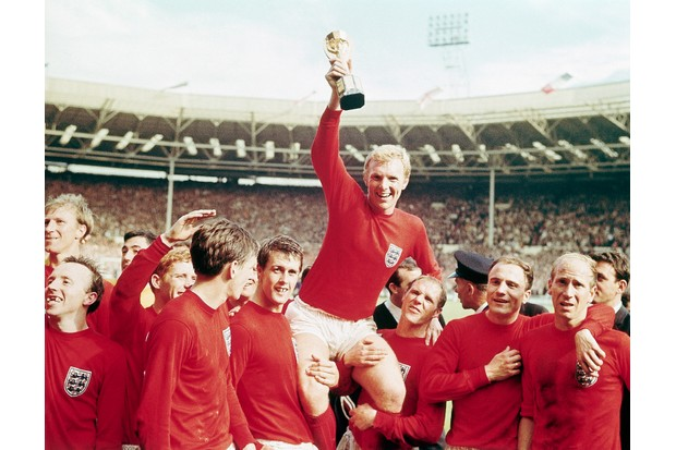 "(Original Caption) 7/30/1966-England-: England captain Bobby Moore ""chaired"" by his team with the Jules Rimet Cup...after receiving it from the Queen after England won the Cup final 4 goals to 2, against West Germany."