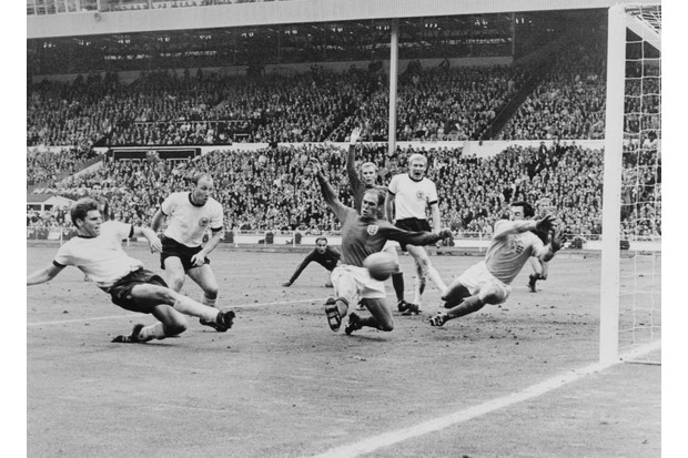 In the 89th minute, Wolfgang Weber (far left) scored West Germany's second goal, bringing the score to 2–2 and forcing the game to extra time. England's Bobby Moore, the team's captain, is seen raising his hand in the background. (Photo by Bettmann/Getty Images)