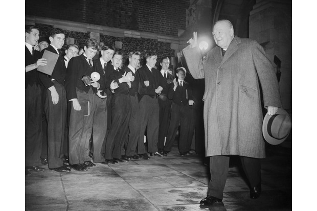 Former British prime minister Winston Churchill (1874-1965) gives his victory salute to a group of school boys, c1953. (Photo by Central Press/Hulton Archive/Getty Images)