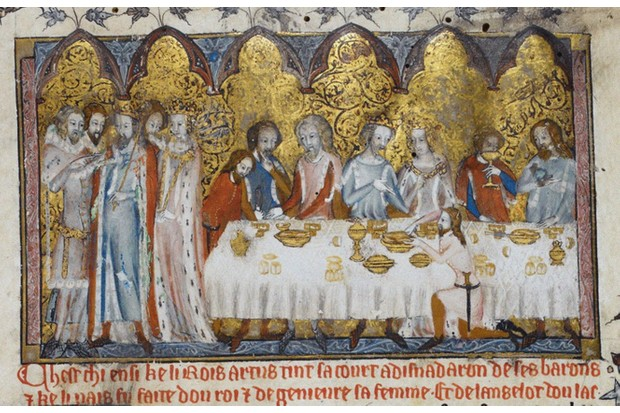 A 13th-century depiction of feasting at King Arthur's court, found in the collection of the British Library. (Photo by Fine Art Images/Heritage Images/Getty Images)
