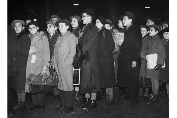Refugees from Germany and Austria who have been living at Dovercourt Bay Camp arrive at Liverpool Street Station, London, in 1938. (Photo by © Hulton-Deutsch Collection/CORBIS/Corbis via Getty Images)