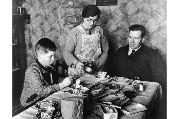 The Kindertransport evacuated some 10,000 children endangered by the Nazi regime to the United Kingdom. Here, 11-year-old Otto Busch from Vienna sits with his foster family, Mr and Mrs Guest, in 1939. (Photo by Kurt Hutton/Hulton Archive/Getty Images)