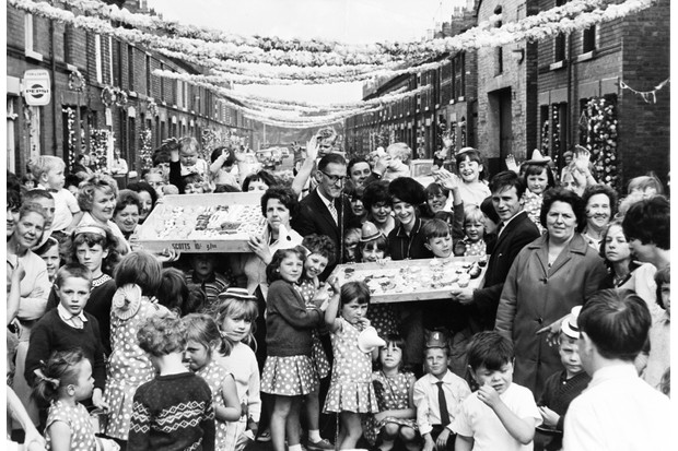 As the host nation for the 1966 World Cup tournament, many people around the country were swept up in the England team's success and a number of street parties were held. Here, residents of Leta Street, Liverpool – near Everton's Goodison Park ground, where some of the tournament matches were played – celebrate with cakes and party hats. (Photo by SSPL/Getty Images)