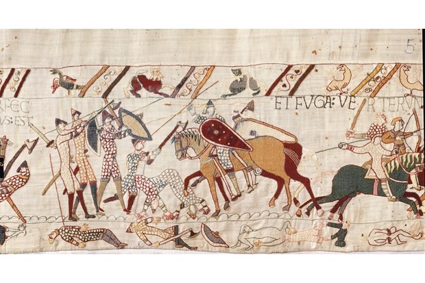 Fig 1: Four of the 93 penises featured in the Bayeux Tapestry are attached to men – what may be a fifth appears on a soldier's corpse in the margin below a late stage in the battle of Hastings (pictured bottom-centre right here), as his chain mail is stripped from him. (© Bayeux Museum)