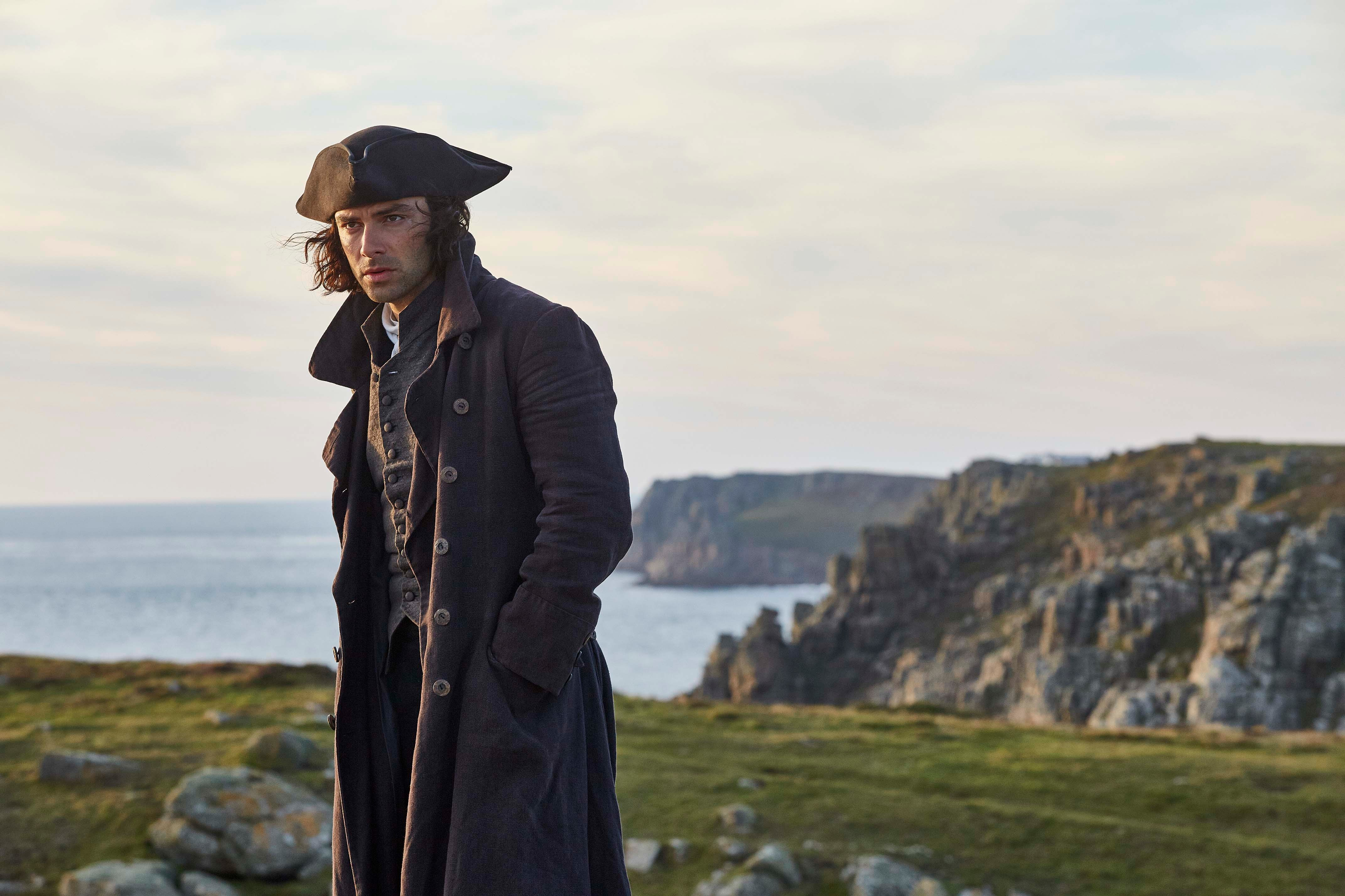 """Aidan Turner as Ross Poldark. The BBC television drama is putting Cornwall's coastline at risk of """"over-tourism"""" as visitors flock to the area to visit the show's scenic filming locations, tourism chiefs have warned. (Photo by BBC/Mammoth Screen/Mike Hogan)"""
