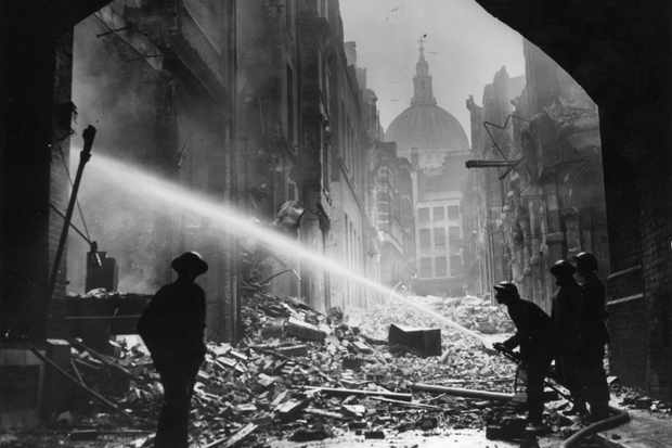 Firemen tackling a blitz fire at St Paul's Cathedral, London