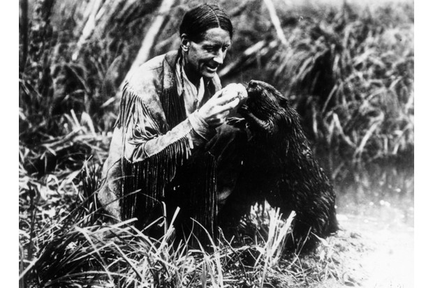 English-born environmentalist and author Grey Owl (1888–1938) feeding a beaver, c1930. (Photo by Topical Press Agency/Getty Images)