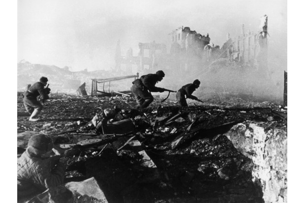 Red Army troops amidst the ruins of war-torn Stalingrad during the Second World War. (Photo by Georgi Zelma/Slava Katamidze Collection/Getty Images)