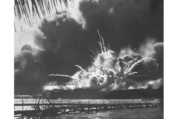 The US destroyer USS 'Shaw' explodes during the early morning air attack on Pearl Harbor on the island of Oahu, near Honolulu. (Photo by Time Life Pictures/US Navy/The LIFE Picture Collection/Getty Images)