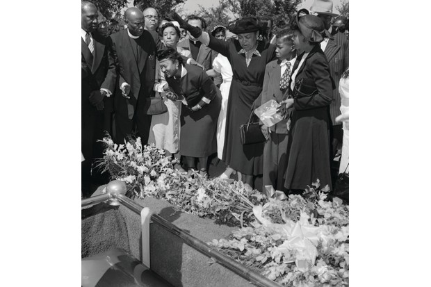 Mamie Till Bradley is comforted as her son's coffin is lowered into its grave in Alsip, Illinois, on 6 September 1955. The funeral followed four days in which Emmett Till's body lay in state. (Photo by Getty Images)